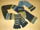 Super easy double knit scarfie to make a matching set to my half fingered gloves!  Featured in the Provo Craft Knifty Knitter Infomercial: Fall 2009