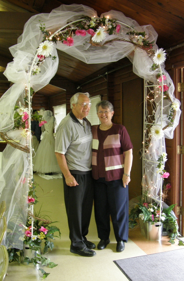 Mom and Dad under Arch